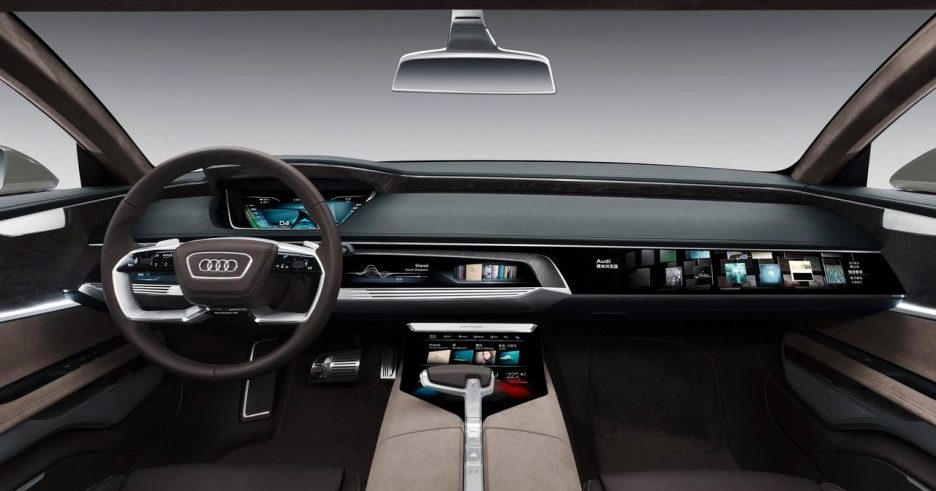 Planche de bord du concept Audi Prologue proposant un large écran tactile pour le passager